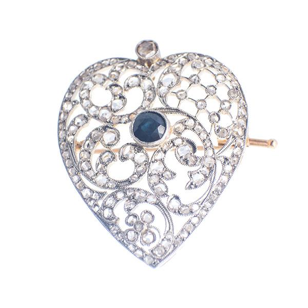 Broche y colgante en oro blanco diamantes y un zafiro