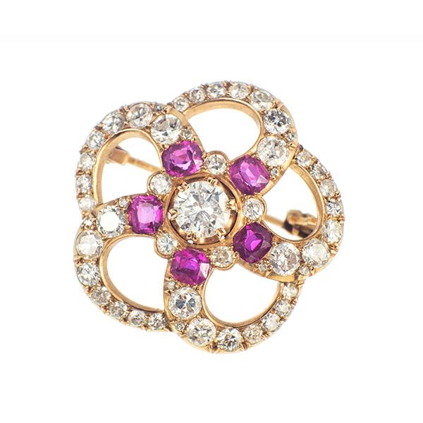 Broche de oro montado con diamantes y rubíes