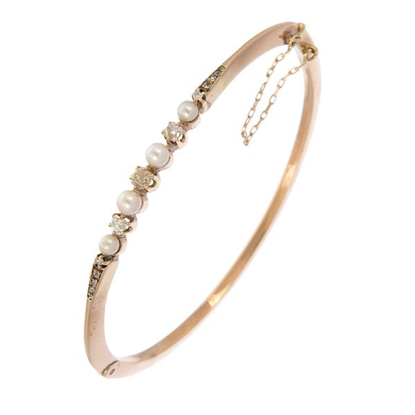 Pulsera rígida de oro amarillo con perlas y diamantes